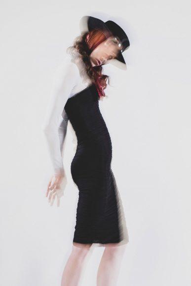 Blue bodysuit: STYLIST'S OWN Bodycon sleeveless draped black dress: JUDY ZHANG  Houndstooth foulard: STYLIST'S OWN  Black Hat: MONTEGALLO ALICE CATENA