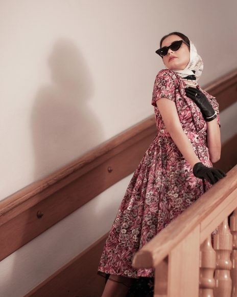 • Foulard and leather gloves by Sous Vintage Shop  • Pink 50's dress by Sous Vintage Shop   • Pearl necklaces and bracelet by Port'Arte  • Sunglasses and ring belong to the Stylist • Bruno Magli white shoes by Sous Vintage Shop