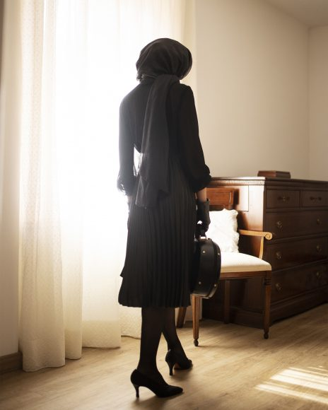 • Earrings by Sous Vintage Shop  • Black wide collar jacket by V/B Studio by Viviana Bertolini  • Roberto Capucci blue foulard by Sous Vintage Shop  • Black Alexander McQueen skirt and stockings belong to the Stylist • Brown leather bag by Sous Vintage Shop