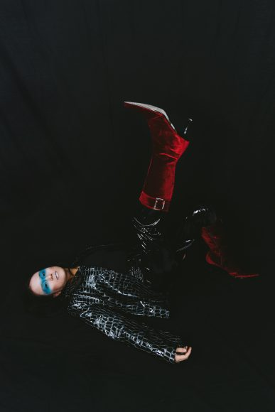 Jacket: Kikiricki Vinyl trousers: Collusion Earrings: UNOde50 Boots: Malone Souliers