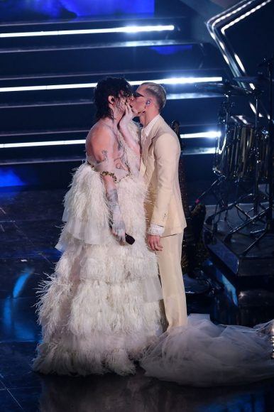 Achille Lauro and Boss Doms kiss on stage during the 71th Sanremo Music Festival 2021 at Teatro Ariston on March 05, 2021 in Sanremo
