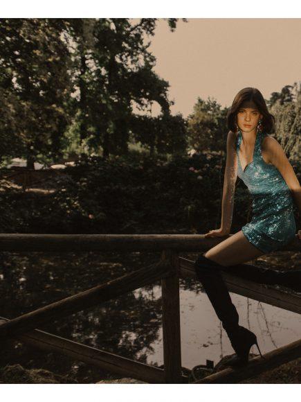 DRESS: Nite Line vintage courtesy of Ro.Ca.Gi EARRINGS: Carlo Zini Bijoux RINGS: Carlo Zini Bijoux HIGH BOOTS: LeSilla